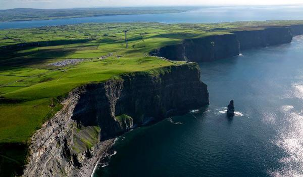 The Cliffs of Moher plunge a dramatic 700 feet into the Atlantic Ocean below.