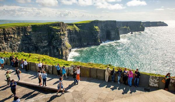 Enjoying the Spectacular View at the 700-foot Cliffs of Moher in County Clare.