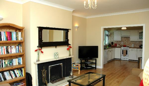 Charmette's Living Room offers you a fireplace, flat screen TV, and many books to choose from!