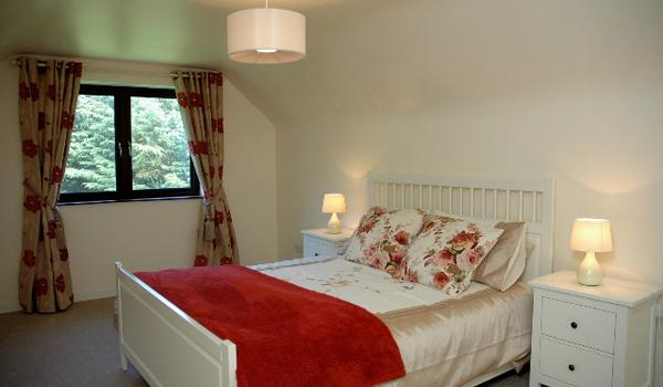 Upstairs Bedroom with Queen Bed.  Overlooks the Private Garden.