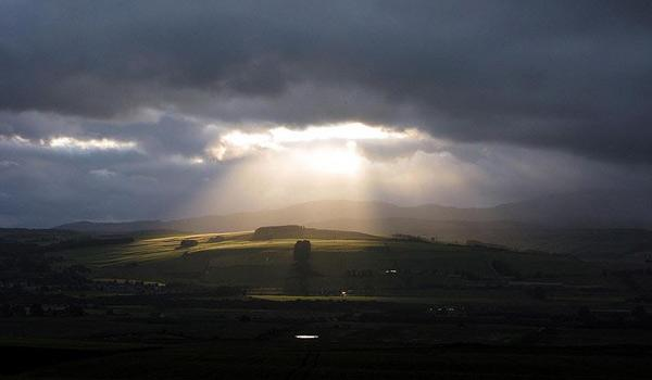 The sun breaks through the clouds over the Black Isle, north of Inverness