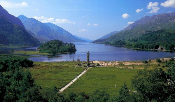 The Glenfinnan Highlands with commemorative Glenfinnan Monument in foreground.