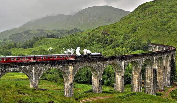 The Jacobite Steam Train (A.K.A. The Hogwarts Express!) crosses the Glenfinnan Viaduct