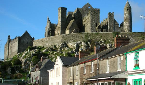 The Rock of Cashel Medieval Fortress rises behind the Village.