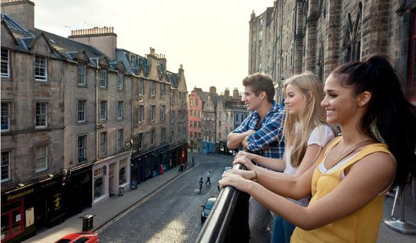 Enjoying the sights and sounds of historic Grassmarket Street in Edinburgh.