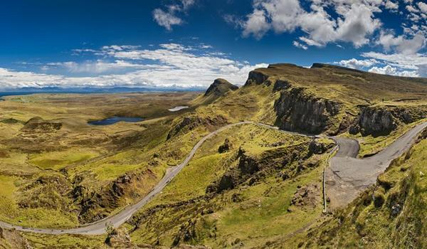 A winding mountain road on the stunning Isle of Skye.
