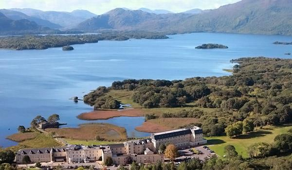 Aerial view of the lake hotel with Killarney lake and mountains in background