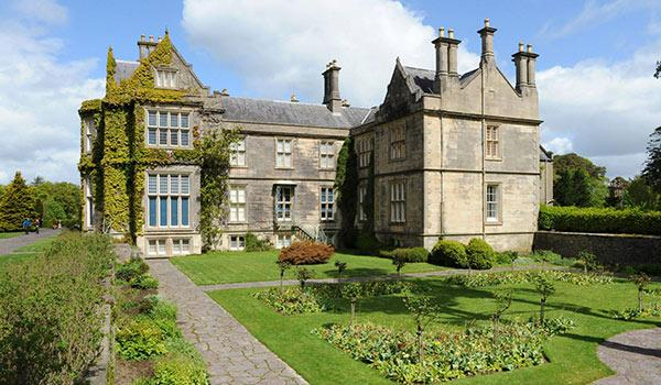 Muckross House and gardens outside view of lawn and mansion