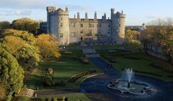 Aerial view of Kilkenny Castle and gardens parkland with River Nore and fountain in front