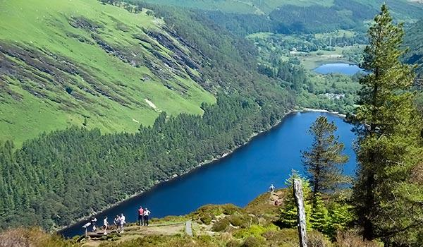 Hikers overlooking Glendalough River in County Wicklow