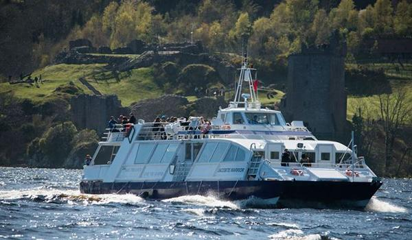 Passengers on board the loch ness cruise taking photos