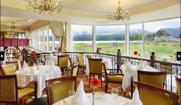 dining tables and placemats set for dinner at the lake hotel overlooking the lake from windows